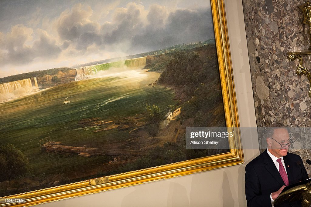 Sen. Charles Schumer, (D-NY) Chairman of the Joint Congressional Committee on Inaugural Ceremonies, speaks about a painting of Niagara Falls, behind, that he had hung for the day's events during the Inaugural Luncheon in Statuary Hall on inauguration day at the U.S. Capitol building January 21, 2013 in Washington D.C. U.S. President Barack Obama, will be ceremonially sworn in for his second term today.