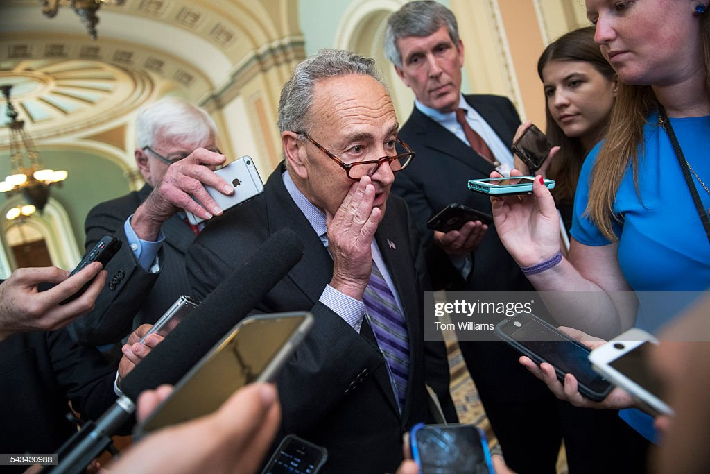 Sen. Charles Schumer, D-Nev., talks with reporters after a news conference after the Senate Policy luncheons in the Capitol, June 28, 2016.