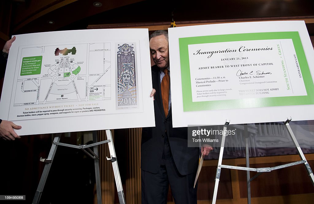 Sen. Charles Schumer, D-N.Y., Chairman of the Joint Congressional Committee on Inaugural Ceremonies, sets up visuals of a map of the Capitol grounds and the ticket for the presidential inauguration, before a news conference in the Capitol.