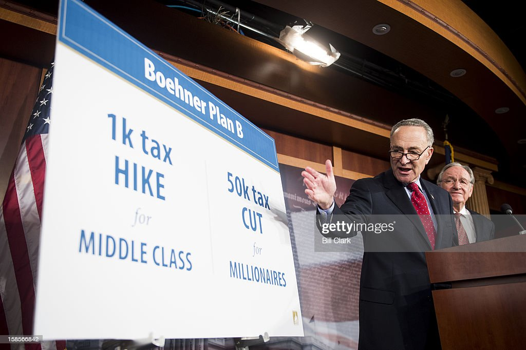 Sen. Charles Schumer, D-N.Y., left, and Sen. Tom Harkin, D-Iowa, hold a news conference in the Capitol to respond to Speaker Boehner's 'plan B' for the fiscal cliff on Wednesday, Dec. 19, 2012.