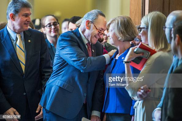 Sen Charles Schumer DNY Senate minority leader for the 115th Congress greets Sen Tammy Baldwin DWis after the Senate Democratic Caucus meeting in the...