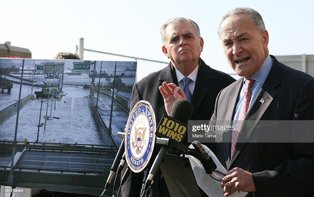 U.S. Sen. <a gi-track='captionPersonalityLinkClicked' href=/galleries/search?phrase=Charles+Schumer&family=editorial&specificpeople=171249 ng-click='$event.stopPropagation()'>Charles Schumer</a> (R), D-NY, speaks as U.S. Secretary of Transportation <a gi-track='captionPersonalityLinkClicked' href=/galleries/search?phrase=Ray+LaHood&family=editorial&specificpeople=598728 ng-click='$event.stopPropagation()'>Ray LaHood</a> looks on next to a photo of Hurricane Sandy flooding on February 15, 2013 in New York City. LaHood announced that New York state will receive $250 million in fast track funding to repair road infrastrcture damaged by Hurricane Sandy.