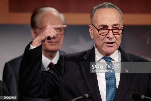 S Sen Charles Schumer holds a symbolic gun to his head during a news conference about funding for the Federal Aviation Administration at the US...