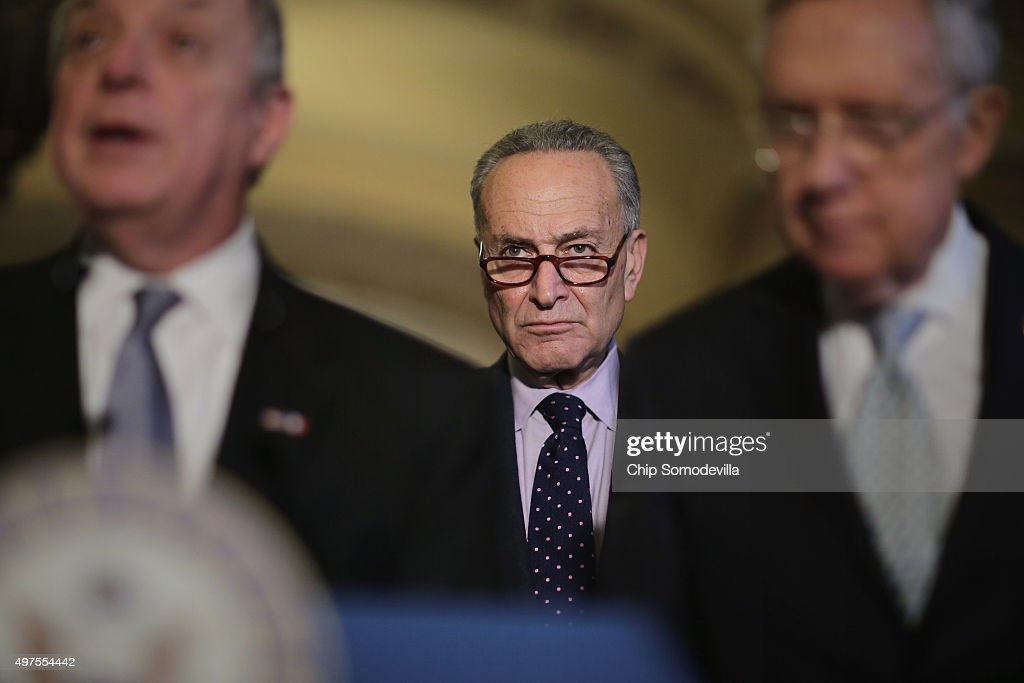Sen. <a gi-track='captionPersonalityLinkClicked' href=/galleries/search?phrase=Charles+Schumer&family=editorial&specificpeople=171249 ng-click='$event.stopPropagation()'>Charles Schumer</a> (D-NY) (C) joins Senate Minority Whip Richard Durbin (D-IL) (L) and Senate Majority Leader <a gi-track='captionPersonalityLinkClicked' href=/galleries/search?phrase=Harry+Reid&family=editorial&specificpeople=203136 ng-click='$event.stopPropagation()'>Harry Reid</a> (D-NV) following the weekly Senate Democratic policy luncheon at the U.S. Capitol November 17, 2015 in Washington, DC. Senate Democratic leaders said they will wait until after being briefed by the White House later this week before deciding how to proceed with allowing more refugees from Syria into the United States.