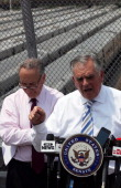 S Sen Charles Schumer looks on as US Transportation Secretary Ray LaHood speaks at a news conference at the Hudson Yards site in Manhattan on May 30...