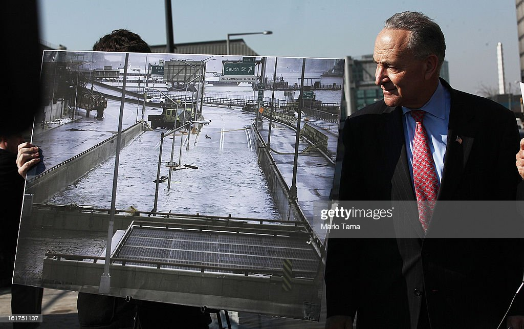U.S. Sen. Charles Schumer (D-NY) looks on next to a photo of Hurricane Sandy flooding on February 15, 2013 in New York City. U.S. Secretary of Transportation Ray LaHood announced that New York state will receive $250 million in fast track funding to repair road infrastrcture damaged by Hurricane Sandy.