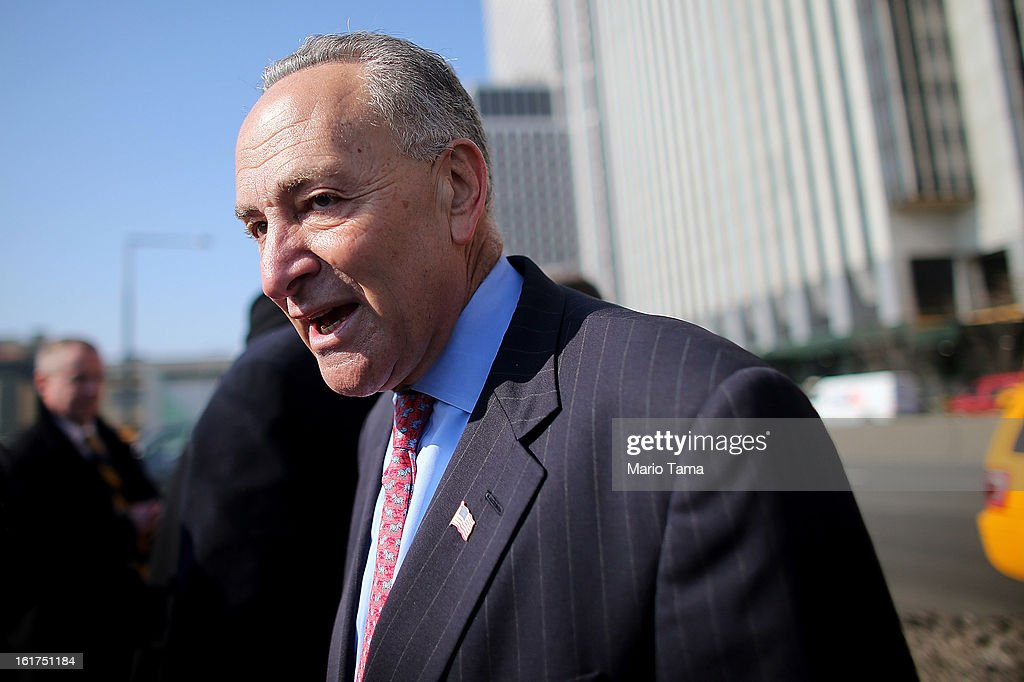 U.S. Sen. <a gi-track='captionPersonalityLinkClicked' href=/galleries/search?phrase=Charles+Schumer&family=editorial&specificpeople=171249 ng-click='$event.stopPropagation()'>Charles Schumer</a> (D-NY) looks on next to a photo of Hurricane Sandy flooding on February 15, 2013 in New York City. U.S. Secretary of Transportation Ray LaHood announced that New York state will receive $250 million in fast track funding to repair road infrastrcture damaged by Hurricane Sandy.