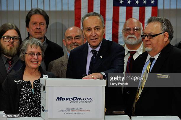 Sen Charles Schumer meets with a delegation of gun owners from Moveonorg delivering more than 1 million petition signatures calling on Congress and...