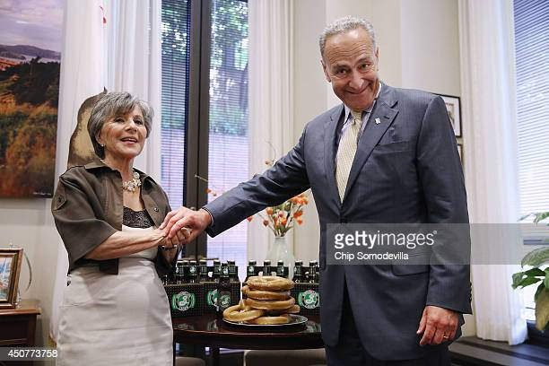 S Sen Charles Schumer presents US Sen Barbara Boxer with pretzels and beer from New York to settle a wager the two had over the National Hockey...