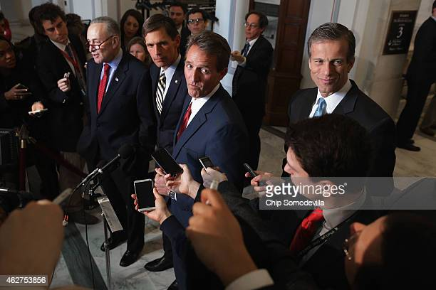 Sen Charles Schumer Sen Martin Heinrich Sen Jeff Flake and Sen John Thune talks to reporters after a Senate bipartisan lunch in the Russell Senate...