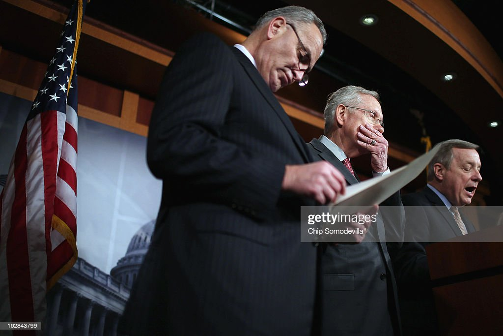 Sen. <a gi-track='captionPersonalityLinkClicked' href=/galleries/search?phrase=Charles+Schumer&family=editorial&specificpeople=171249 ng-click='$event.stopPropagation()'>Charles Schumer</a> (D-NY), Senate Majority Leader <a gi-track='captionPersonalityLinkClicked' href=/galleries/search?phrase=Harry+Reid+-+Politician&family=editorial&specificpeople=203136 ng-click='$event.stopPropagation()'>Harry Reid</a> (D-NV) and Senate Majority Whip Richard Durbin (D-IL) hold a news conference at the U.S. Capitol on the eve of the budget sequester February 28, 2013 in Washington, DC. Referring to the sequester, Senate Chaplain Barry Black opened today's session with the prayer, 'As we anticipate an across-the-board budget cuts across our land, we still expect to see your goodness prevail, O God, and save us from ourselves.'