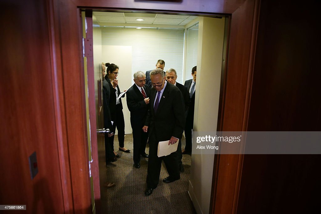 U.S. Sen. Charles Schumer (D-NY) (C), Senate Minority Whip Sen. Richard Durbin (D-IL) (R), and Sen. Jack Reed (D-RI) (L) enter the Senate Radio TV Studio to participate in a news conference June 4, 2015 on Capitol Hill in Washington, DC. The senators held a news conference to discuss the National Defense Authorization Act.