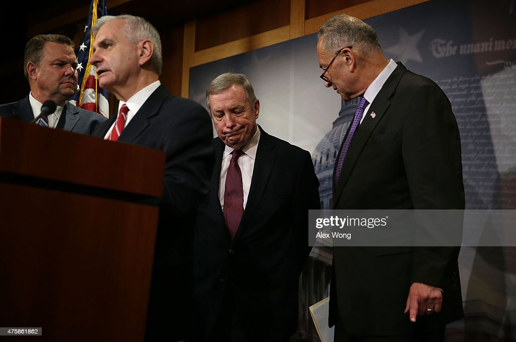 U.S. Sen. Charles Schumer (D-NY) (R), Senate Minority Whip Sen. Richard Durbin (D-IL) (3rd L), Sen. Jack Reed (D-RI) (2nd L), and Sen. Jon Tester (D-MT) (L) participate in a news conference June 4, 2015 on Capitol Hill in Washington, DC. The senators held a news conference to discuss the National Defense Authorization Act.