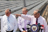 US Sen Charles Schumer speaks as Hudson Yards developer Stephen Ross and US Transportation Secretary Ray LaHood look on at a news conference at the...