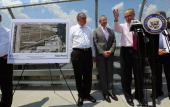 US Sen Charles Schumer speaks as Hudson Yards developer Stephen Ross and and US Transportation Secretary Ray LaHood look on at a news conference at...