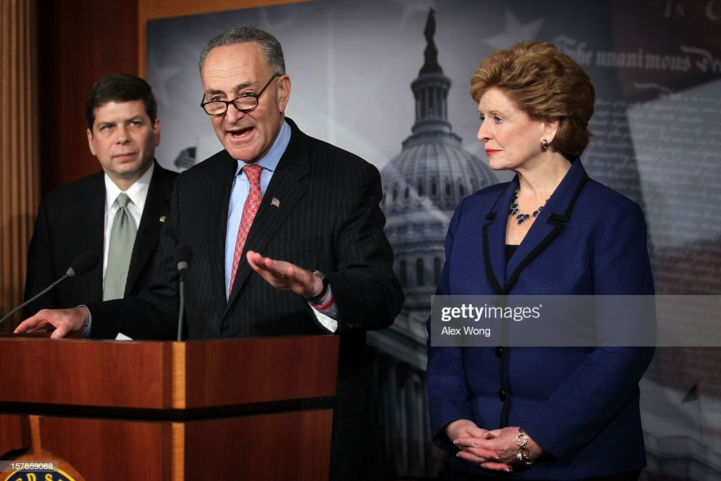 U.S. Sen. Charles Schumer (D-NY) (C) speaks as Sen. Debbie Stabenow (D-MI) (R) and Sen. Mark Begich (D-AK) listen during a news conference December 5, 2012 on Capitol Hill in Washington, DC. The senators held a news conference to call on House Republicans to pass the Senate-passed tax cut bill.