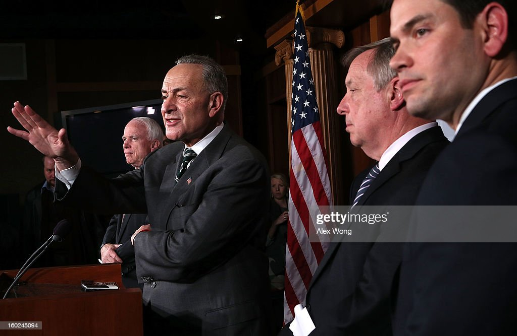 U.S. Sen. <a gi-track='captionPersonalityLinkClicked' href=/galleries/search?phrase=Charles+Schumer&family=editorial&specificpeople=171249 ng-click='$event.stopPropagation()'>Charles Schumer</a> (D-NY) (2nd L) speaks as (L-R) Sen. <a gi-track='captionPersonalityLinkClicked' href=/galleries/search?phrase=John+McCain&family=editorial&specificpeople=125177 ng-click='$event.stopPropagation()'>John McCain</a> (R-AZ), Senate Majority Whip Sen. Richard Durbin (D-IL), and Sen. <a gi-track='captionPersonalityLinkClicked' href=/galleries/search?phrase=Marco+Rubio+-+Politician&family=editorial&specificpeople=11395287 ng-click='$event.stopPropagation()'>Marco Rubio</a> (R-FL) listen during a news conference on a comprehensive immigration reform framework January 28, 2013 on Capitol Hill in Washington, DC. A group of bipartisan senate members have reached to a deal of outlines to reform the national immigration laws that will provide a pathway for the 11 million illegal immigrants in the country to citizenship.