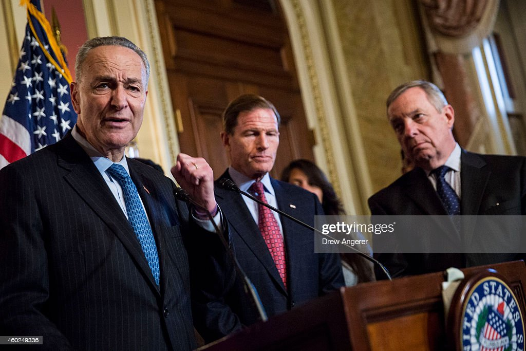 Sen Charles Schumer speaks as Sen Richard Blumenthal and Sen Dick Durbin look on during a news conference to discuss US President Barack Obama's...