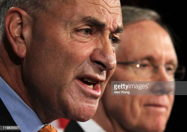 S Sen Charles Schumer speaks as Senate Majority Leader Sen Harry Reid listens during a news conference discussing the latest development of the debt...