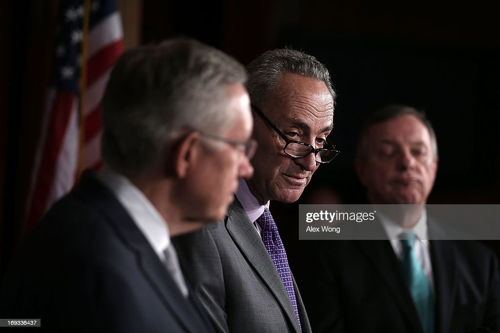 S. Sen. Charles Schumer (D-NY) (2nd L) speaks as Senate Majority Leader Sen. Harry Reid (D-NV) (L) and Senate Majority Whip U.S. Sen. Richard Durbin (D-IL) (R) listen during a news conference May 23, 2013 on Capitol Hill in Washington, DC. The Senate Democratic leadership held a news conference to highlight the continued obstruction by Senate Republicans of President Obama's executive and judicial nominees.