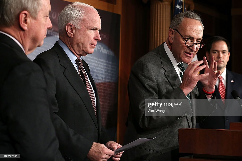 U.S. Sen. <a gi-track='captionPersonalityLinkClicked' href=/galleries/search?phrase=Charles+Schumer&family=editorial&specificpeople=171249 ng-click='$event.stopPropagation()'>Charles Schumer</a> (D-NY) (3rd L) speaks as (L-R) Senate Majority Whip Sen. Richard Durbin (D-IL), Sen. <a gi-track='captionPersonalityLinkClicked' href=/galleries/search?phrase=John+McCain&family=editorial&specificpeople=125177 ng-click='$event.stopPropagation()'>John McCain</a> (R-AZ) and Sen. <a gi-track='captionPersonalityLinkClicked' href=/galleries/search?phrase=Marco+Rubio+-+Politician&family=editorial&specificpeople=11395287 ng-click='$event.stopPropagation()'>Marco Rubio</a> (R-FL) listen during a news conference on a comprehensive immigration reform framework January 28, 2013 on Capitol Hill in Washington, DC. A group of bipartisan senate members have reached to a deal of outlines to reform the national immigration laws that will provide a pathway for the 11 million illegal immigrants in the country to citizenship.