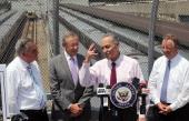 S Sen Charles Schumer speaks as US Transportation Secretary Ray LaHood Hudson Yards developer Stephen Ross and Amtrak Chairman Tony Coscia look on at...
