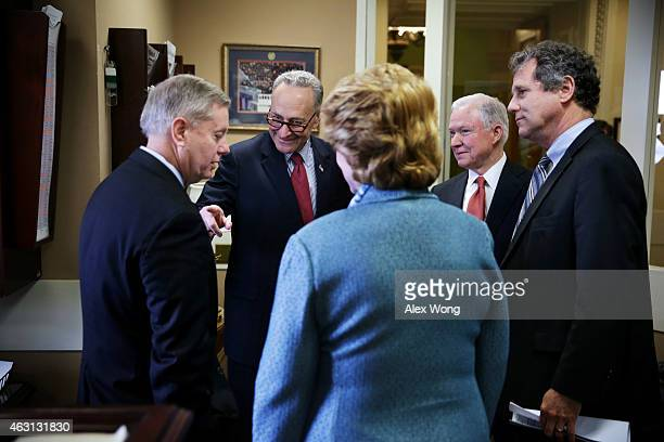 S Sen Charles Schumer talks to Sen Lindsey Graham as Sen Jeff Sessions and Sen Sherrod Brown look on prior to a news conference on currency and trade...