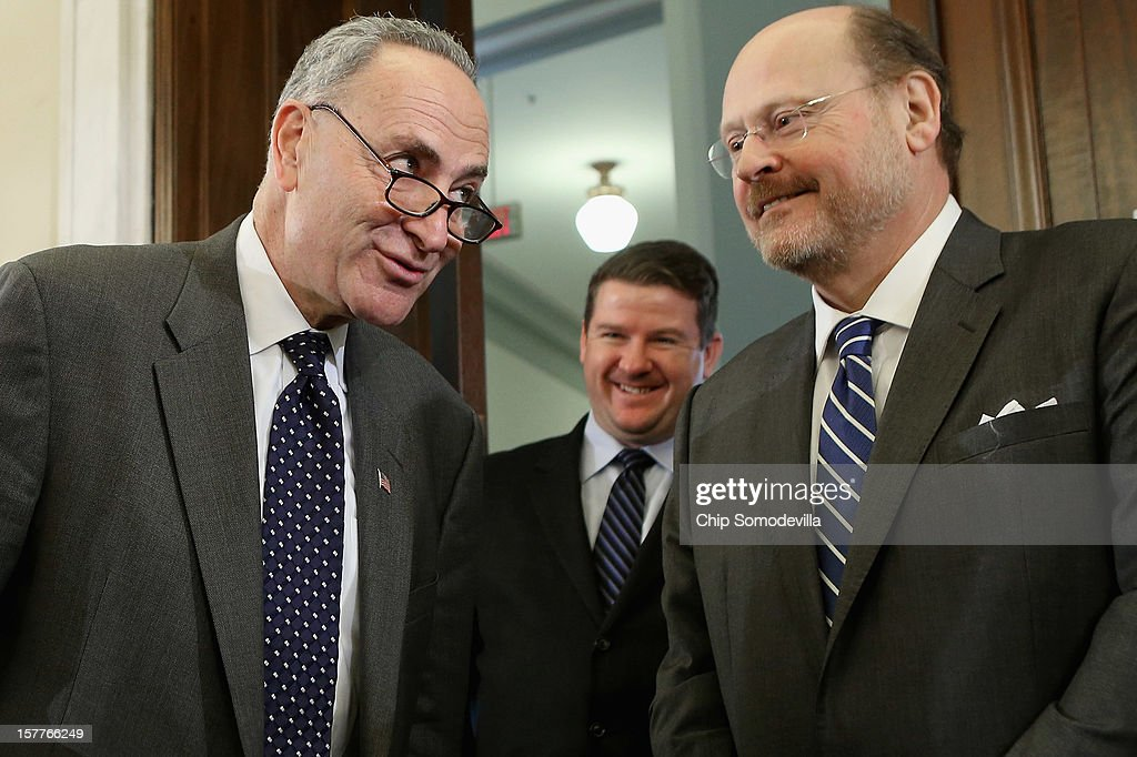 U.S. Sen. <a gi-track='captionPersonalityLinkClicked' href=/galleries/search?phrase=Charles+Schumer&family=editorial&specificpeople=171249 ng-click='$event.stopPropagation()'>Charles Schumer</a> (D-NY) (L) talks with Metropolitan Transportation Authority Chairman and CEO Joseph Lhota (R) before a Senate Surface Transportation and Merchant Marine Infrastructure, Safety, and Security Subcommittee hearing on 'Superstorm Sandy: The Devastating Impact on the Nation's Largest Transportation Systems.' December 6, 2012 in Washington, DC. Lhota, Shumer and others testified before the subcommittee about the need for more federal dollars for Superstorm Sandy recovery.