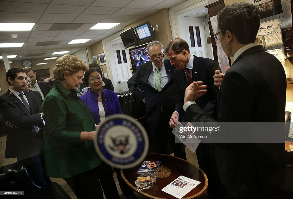 Sen Charles Schumer talks with other Democratic senators before a press conference at the US Capitol March 17 2015 in Washington DC The group of...