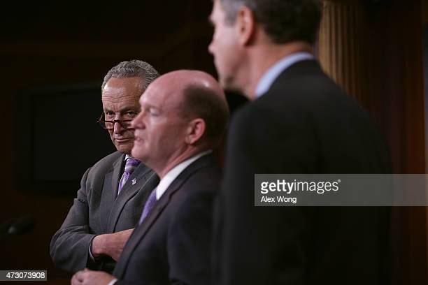 S Sen Chris Coons speaks as Sen Charles Schumer and Sen Sherrod Brown listen during a news conference May 12 2015 on Capitol Hill in Washington DC...