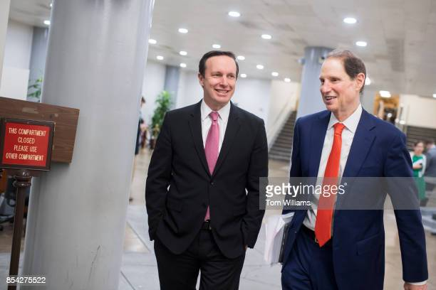 Sen Chris Murphy DConn left and Ron Wyden DOre are seen in the senate subway after Senate Majority Leader Mitch McConnell RKy announced the latest...