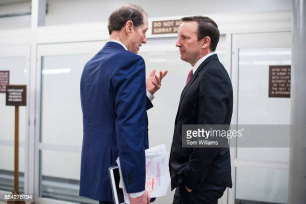 Sen Chris Murphy DConn right and Ron Wyden DOre are seen in the senate subway after Senate Majority Leader Mitch McConnell RKy announced the latest...