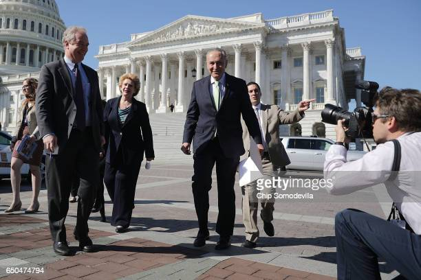 Sen Chris Van Hollen and Senate Minority Leader Charles Schumer head for a news conference with people who may be negatively affected by the proposed...