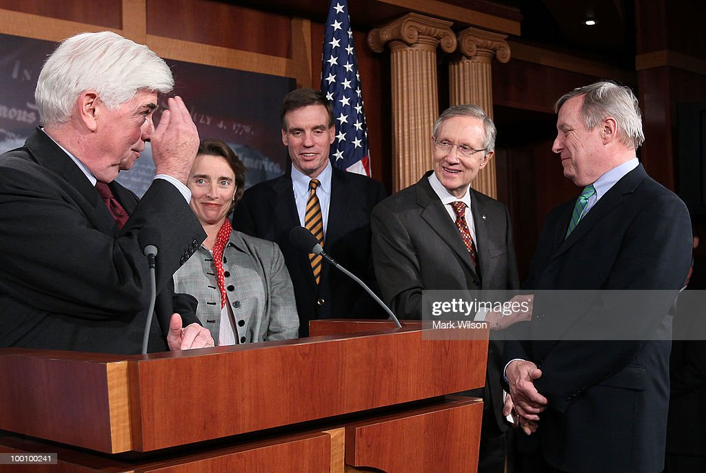 Sen Christopher Dodd salutes Senate Majority Leader Harry Reid with Sen Richard Durbin Sen Blanche Lincoln and Sen Mark Warner after voting to pass...