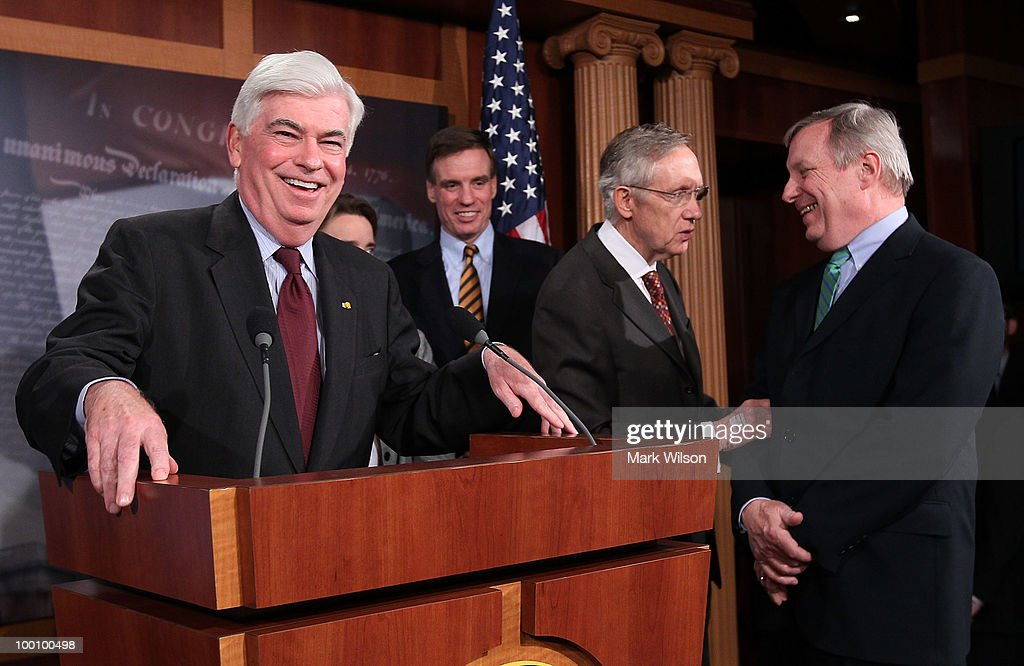 Sen. Christopher Dodd (D-CT) (L), smiles while flanked by Senate Majority Leader Harry Reid (D-NV) (2R), Sen. Richard Durbin (D-IL) (R), Sen. Blanche Lincoln (D-AR) (2L) and Sen. Mark Warner (D-VA), after the Senate voted to pass Wall Street reform, on May 20, 2010 in Washington, DC. In a 59-39 vote the Senate passed the landmark Wall Street regularly reform bill that will increase restrictions on the banking industry.