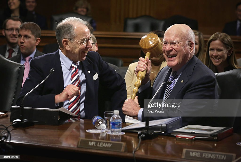 U.S. Sen. <a gi-track='captionPersonalityLinkClicked' href=/galleries/search?phrase=Chuck+Grassley&family=editorial&specificpeople=504960 ng-click='$event.stopPropagation()'>Chuck Grassley</a> (R-IA) (L) looks on as Sen. Patrick Leahy (D-VT) (R) brings out a giant gavel while making remarks during an executive business meeting of the Senate Judiciary Committee January 22, 2015 on Capitol Hill in Washington, DC. Sen. Leahy ceremonially passed the gavel to Sen. Grassley who has taken up the chairmanship after the Republicans won the majority in the Senate of the 114th Congress.