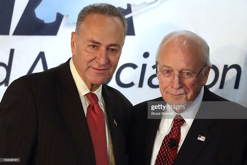 U.S. Sen. Chuck Schumer (D-NY) (L) and former Vice President <a gi-track='captionPersonalityLinkClicked' href=/galleries/search?phrase=Dick+Cheney&family=editorial&specificpeople=125149 ng-click='$event.stopPropagation()'>Dick Cheney</a> pose for photographs following Cheney's appearance at the Long Island Association fall luncheon at the Crest Hollow Country Club on October 18, 2012 in Woodbury, New York. Cheney discussed foreign and domestic issues, including the upcoming presidential election, at the business organization's luncheon.