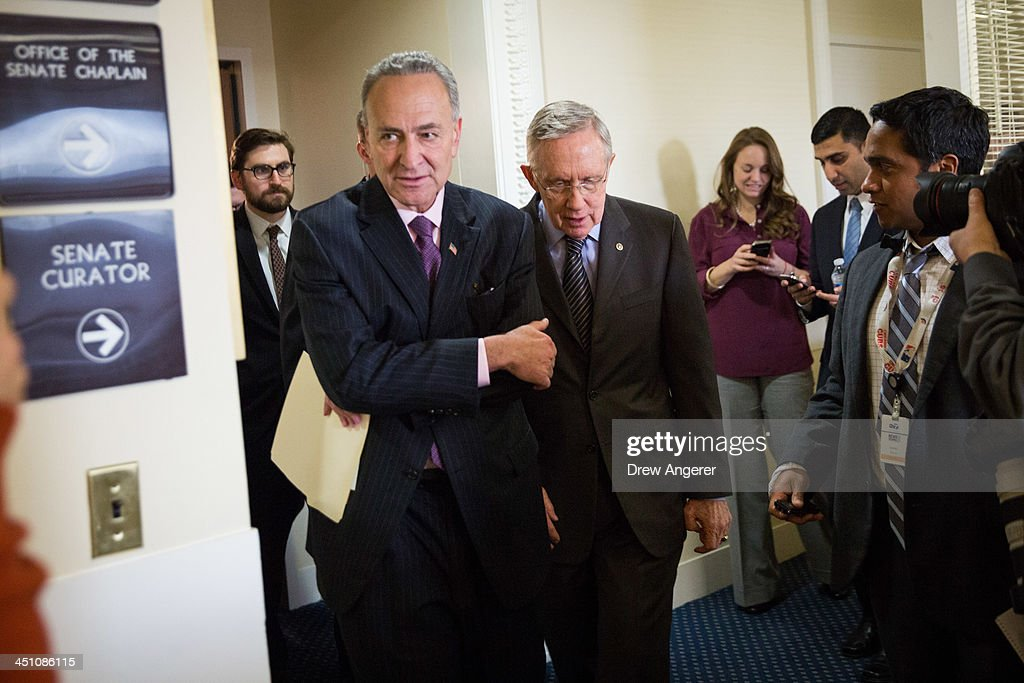 Sen. Chuck Schumer (D-NY) and Senate Majority Leader <a gi-track='captionPersonalityLinkClicked' href=/galleries/search?phrase=Harry+Reid+-+Politician&family=editorial&specificpeople=203136 ng-click='$event.stopPropagation()'>Harry Reid</a> (D-NV) leave a news conference on Capitol Hill, November 21, 2013 in Washington, DC. The Senate voted 52-48 to invoke the so-called 'nuclear option', voting to change Senate rules on the controversial filibuster for most presidential nominations with a simple majority vote.