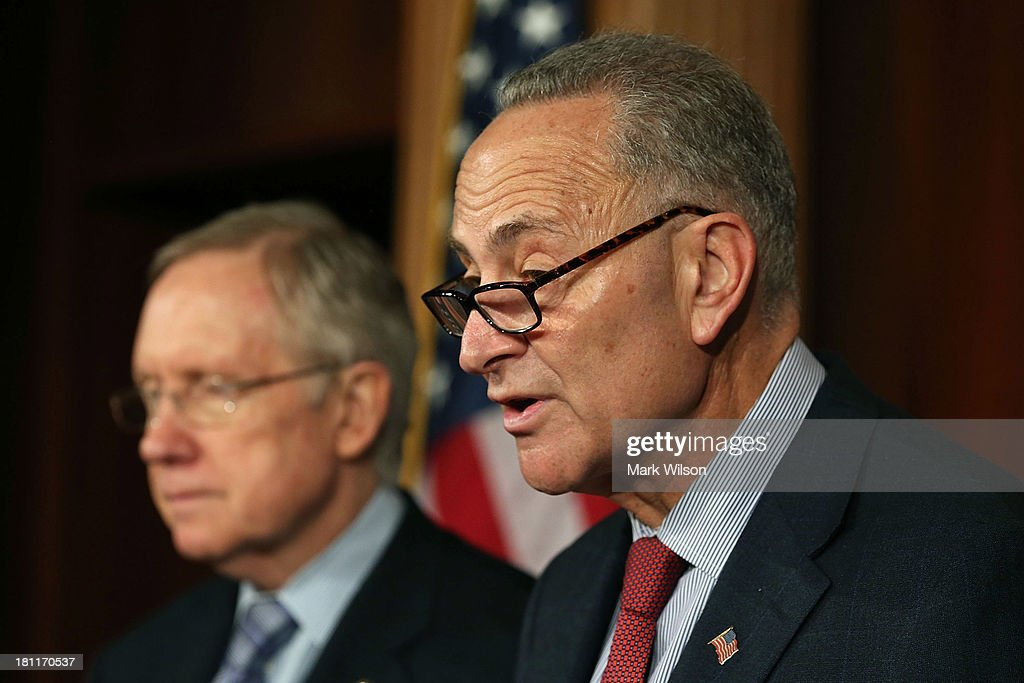 Sen. Chuck Schumer (D-NY) (R) and Senate Majority Leader <a gi-track='captionPersonalityLinkClicked' href=/galleries/search?phrase=Harry+Reid+-+Politician&family=editorial&specificpeople=203136 ng-click='$event.stopPropagation()'>Harry Reid</a> (D-NV) speak to the media during a news conference on Capitol Hill, September 19, 2013 in Washington, DC. Leader Reid spoke about the continuing resolution and Republican efforts to defund Obamacare.