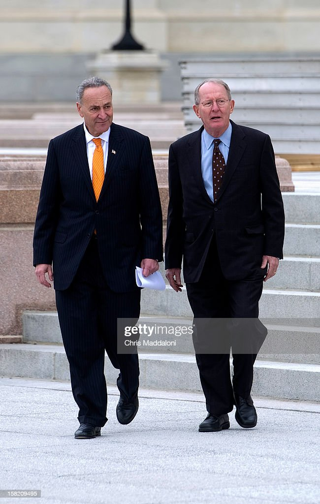 Sen. Chuck Schumer, D-N.Y.; and Sen. Lamar Alexander, R-Tenn., arrive to show the press the finishing touches of the stands at the U.S. Capitol for President Barack Obama's Inauguration on January 21, 2013.