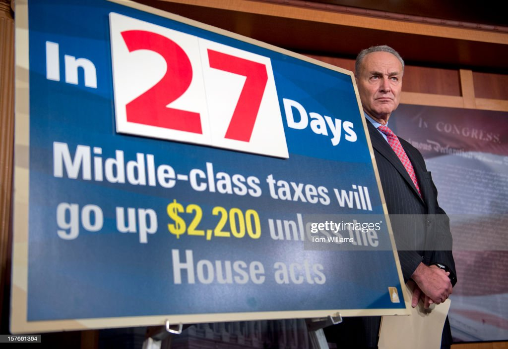 Sen. Chuck Schumer, D-N.Y., attends a news conference in the Capitol calling on the House to act on a Senate passed tax cut bill that would help the middle class.