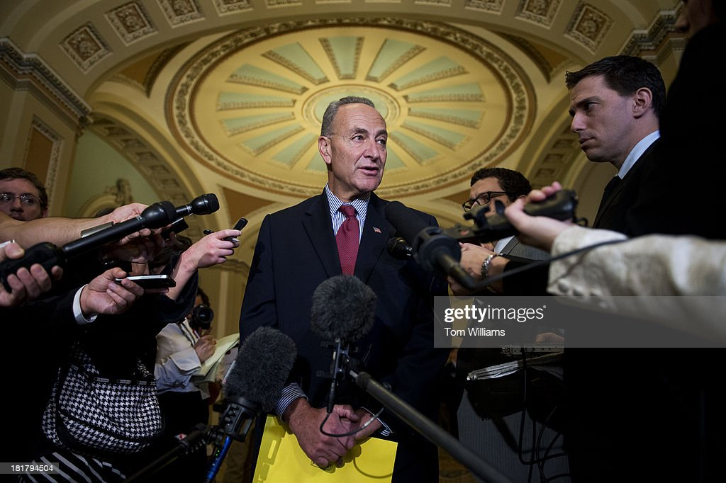 Sen. Chuck Schumer, D-N.Y., talks with reporters about the 21 hour talk by Sen. Ted Cruz, R-Texas, on the Senate floor against President Obama's health care law.