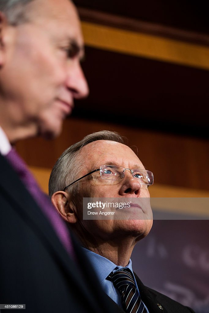 Sen. Chuck Schumer (D-NY) looks on while Senate Majority Leader <a gi-track='captionPersonalityLinkClicked' href=/galleries/search?phrase=Harry+Reid+-+Politician&family=editorial&specificpeople=203136 ng-click='$event.stopPropagation()'>Harry Reid</a> (D-NV) speaks during a news conference on Capitol Hill, November 21, 2013 in Washington, DC. The Senate voted 52-48 to invoke the so-called 'nuclear option', voting to change Senate rules on the controversial filibuster for most presidential nominations with a simple majority vote.