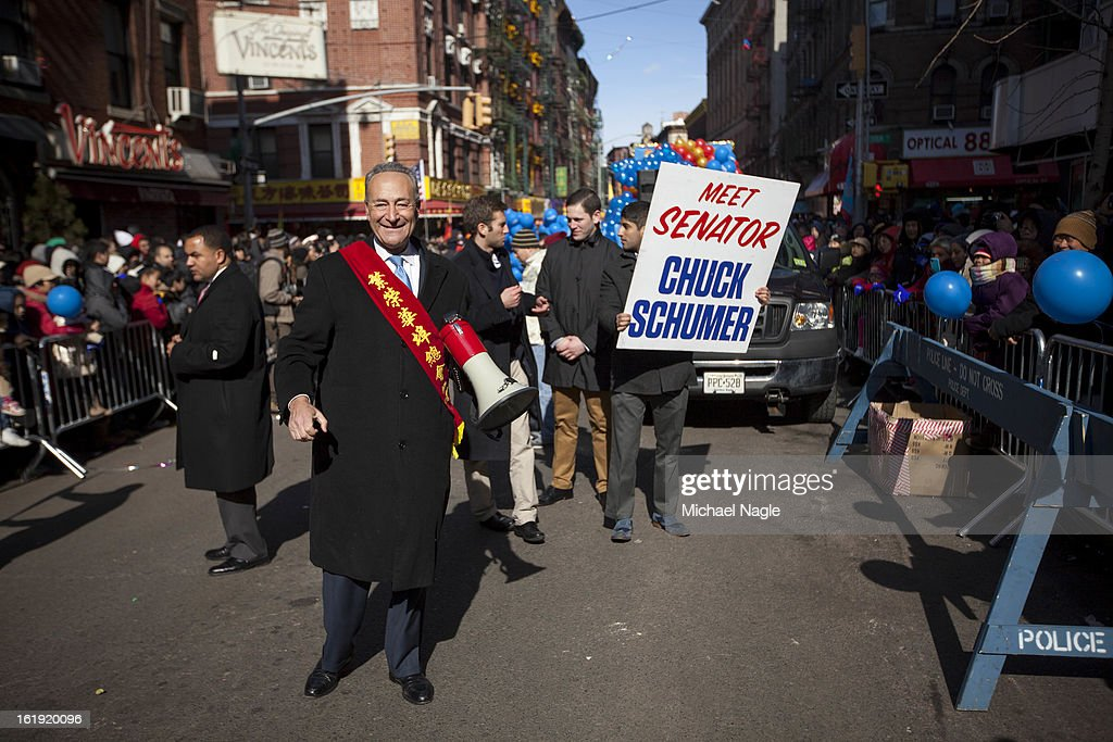 U.S. Sen. Chuck Schumer (D-NY) marches in the 14th Annual Chinatown Lunar New Year Parade on February 17, 2013 in New York City. This year celebrates the Year of the Snake.