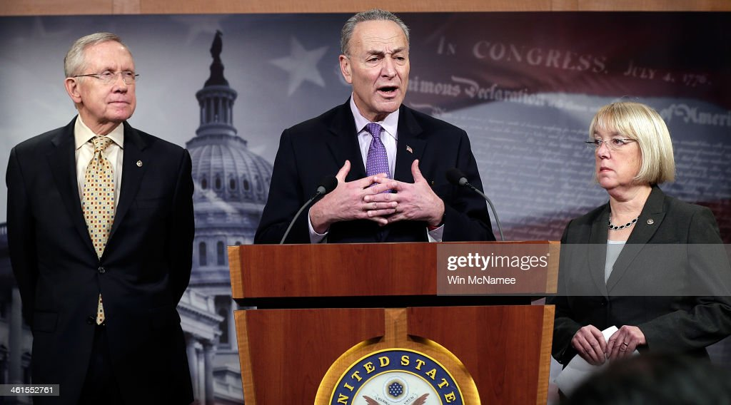 Sen Chuck Schumer Senate Majority Leader Harry Reid and Sen Patty Murray answer questions during a press conference January 9 2014 in Washington DC...