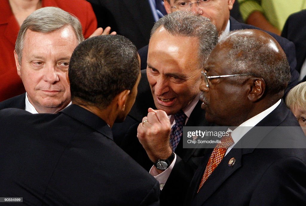 Sen. Chuck Schumer (D-NY) (2R) talks to U.S. President <a gi-track='captionPersonalityLinkClicked' href=/galleries/search?phrase=Barack+Obama&family=editorial&specificpeople=203260 ng-click='$event.stopPropagation()'>Barack Obama</a> (2L) after Obama addressed a joint session of the U.S. Congress at the U.S. Capitol as Sen. Richard Durbin (D-IL) (R) and Rep. Jim Clyburn (D-SC) look on September 9, 2009 in Washington, DC. Obama addressed the joint session to urge passage of his national health care plan, the centerpiece of his domestic agenda.