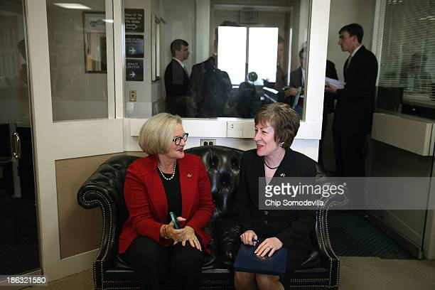 Sen Claire McCaskill and Sen Susan Collins talk before a news conference at the US Capitol October 30 2013 in Washington DC The senators are...