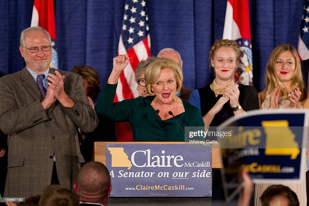 U.S. Sen. Claire McCaskill (D-MO) speaks to supporters as her husband Joseph Shepard (L) and other family members look on during an election night party November 6, 2012 in St. Louis, Missouri. McCaskill won in her re-election bid against U.S. Rep. Todd Akin (R-MO) for the Missouri U.S. senate seat.