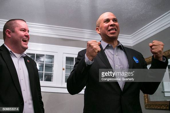 STATES JANUARY 20 Sen Cory Booker DNJ speaks alongside organizer Sean Bagniewski at an organizing event at a private home in Des Moines Iowa Saturday...