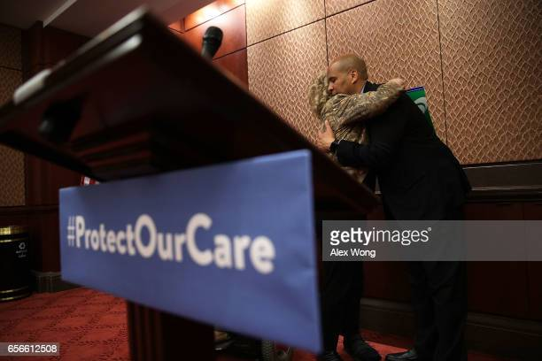 S Sen Cory Booker hugs retired social worker Patricia Byrd of Panama City Florida whose 92yearold mother is on Medicaid during a news conference...